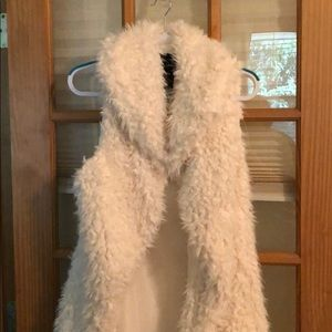 Me Jane white fur vest.